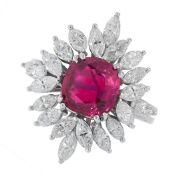 UNHEATED RUBY AND DIAMOND RING in cluster design, set with a cushion cut ruby of 2.93 carats in a