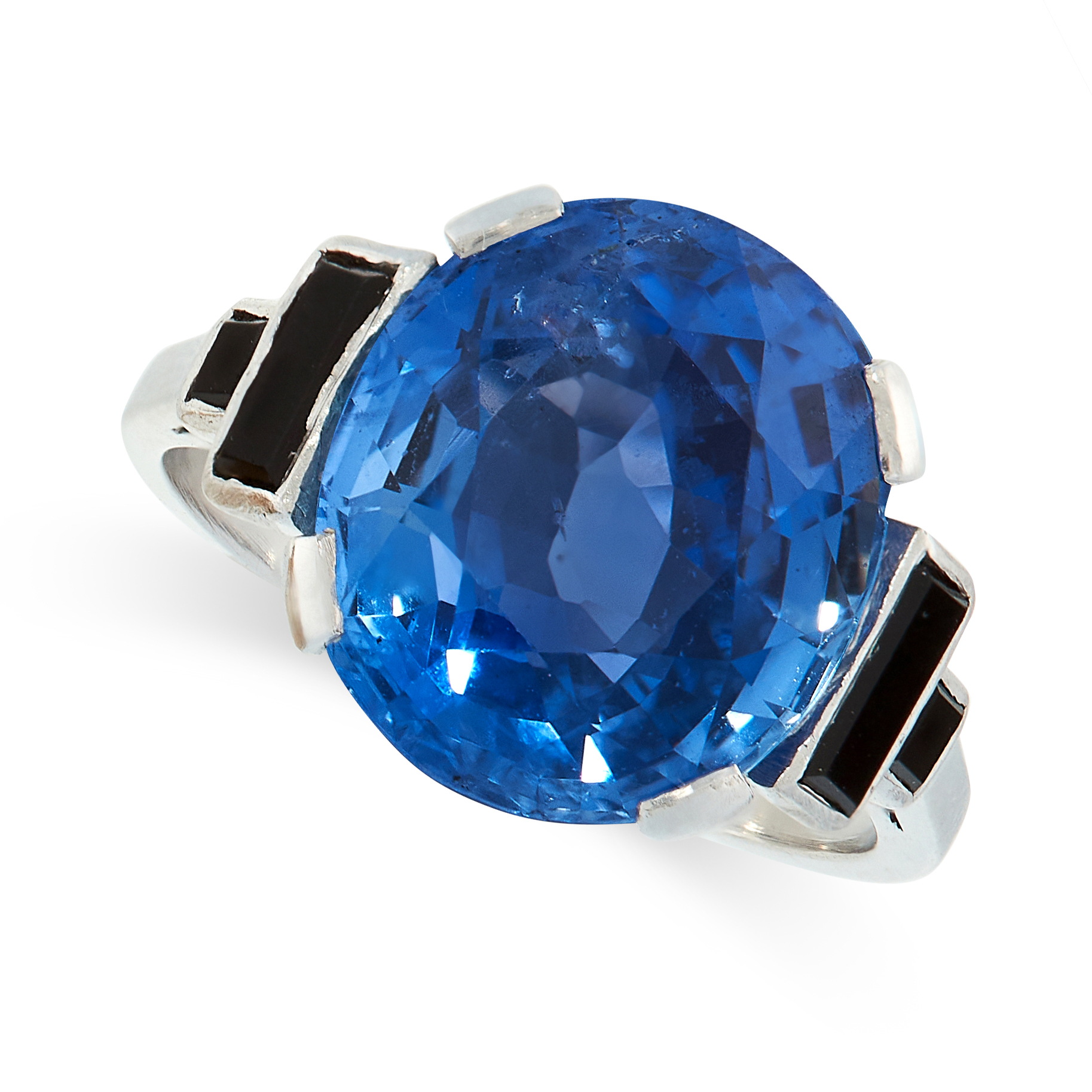 CEYLON NO HEAT SAPPHIRE AND ONYX RING comprising of an oval cut sapphire of 8.66 carats between