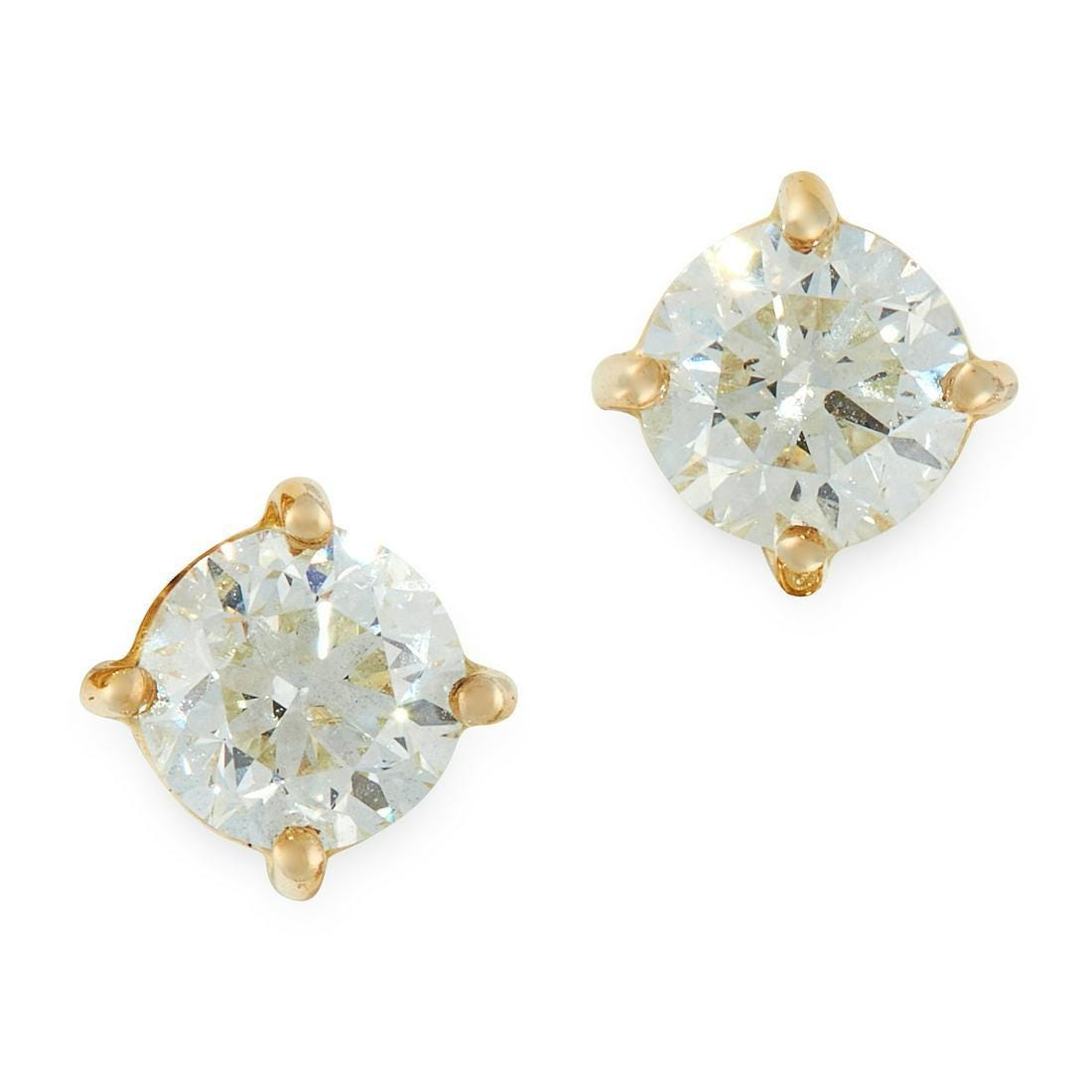 PAIR OF DIAMOND STUD EARRINGS in 18ct yellow gold, each set with a round cut diamond, both totalling