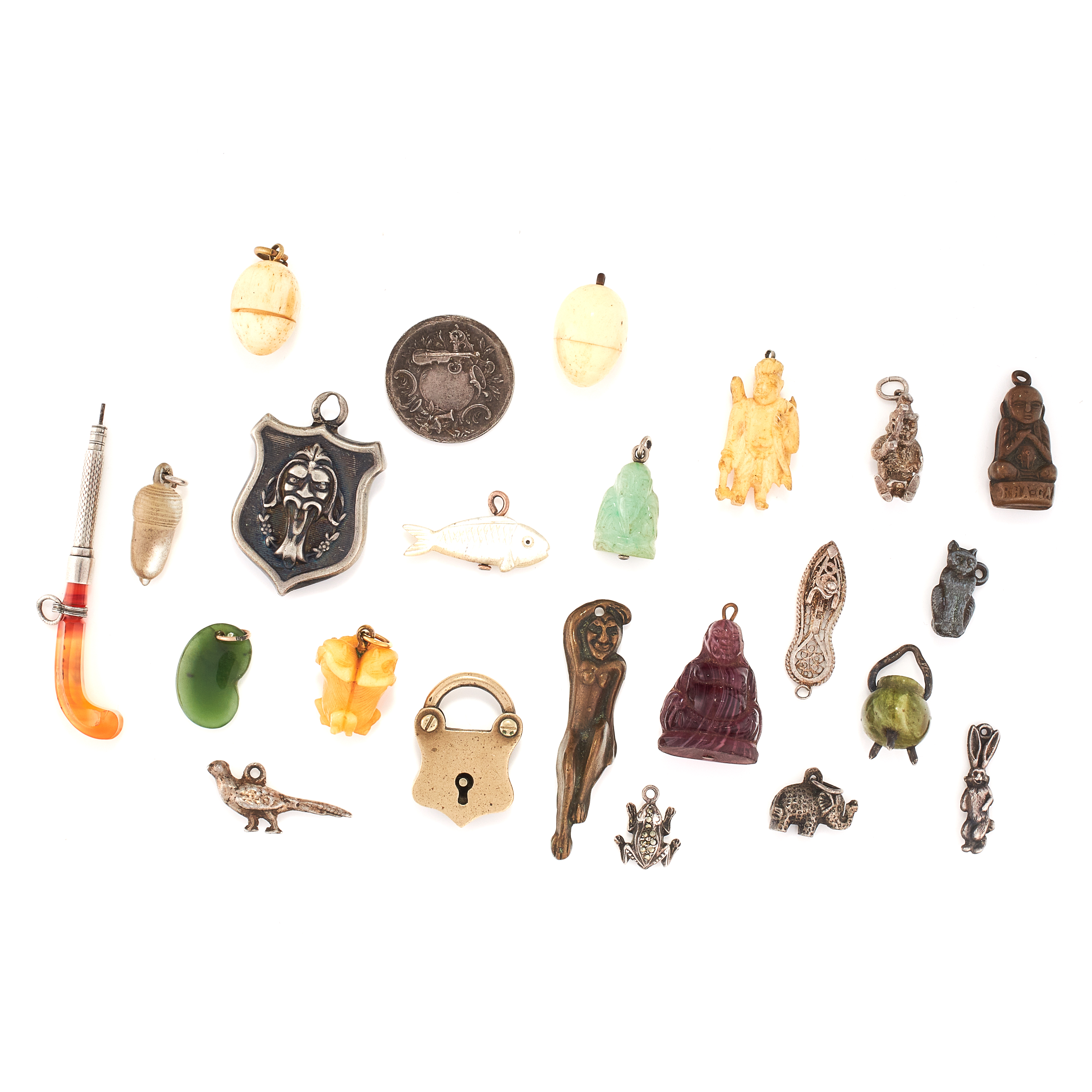 A MIXED LOT OF ANTIQUE CHARMS comprising of two carved ivory egg charms, each containing a small