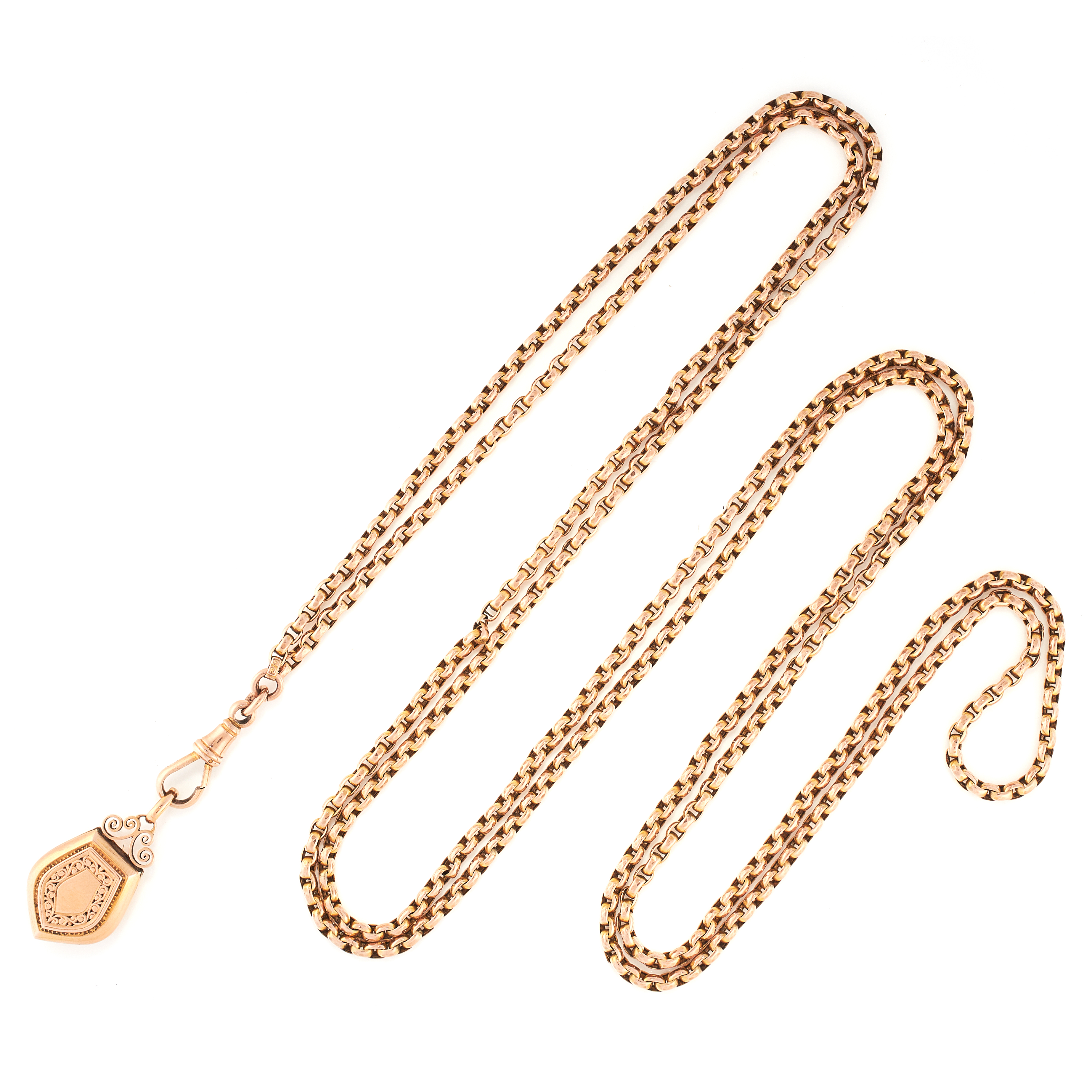 AN ANTIQUE GUARD CHAIN AND LOCKET NECKLACE in yellow gold, the guard chain suspending a shield