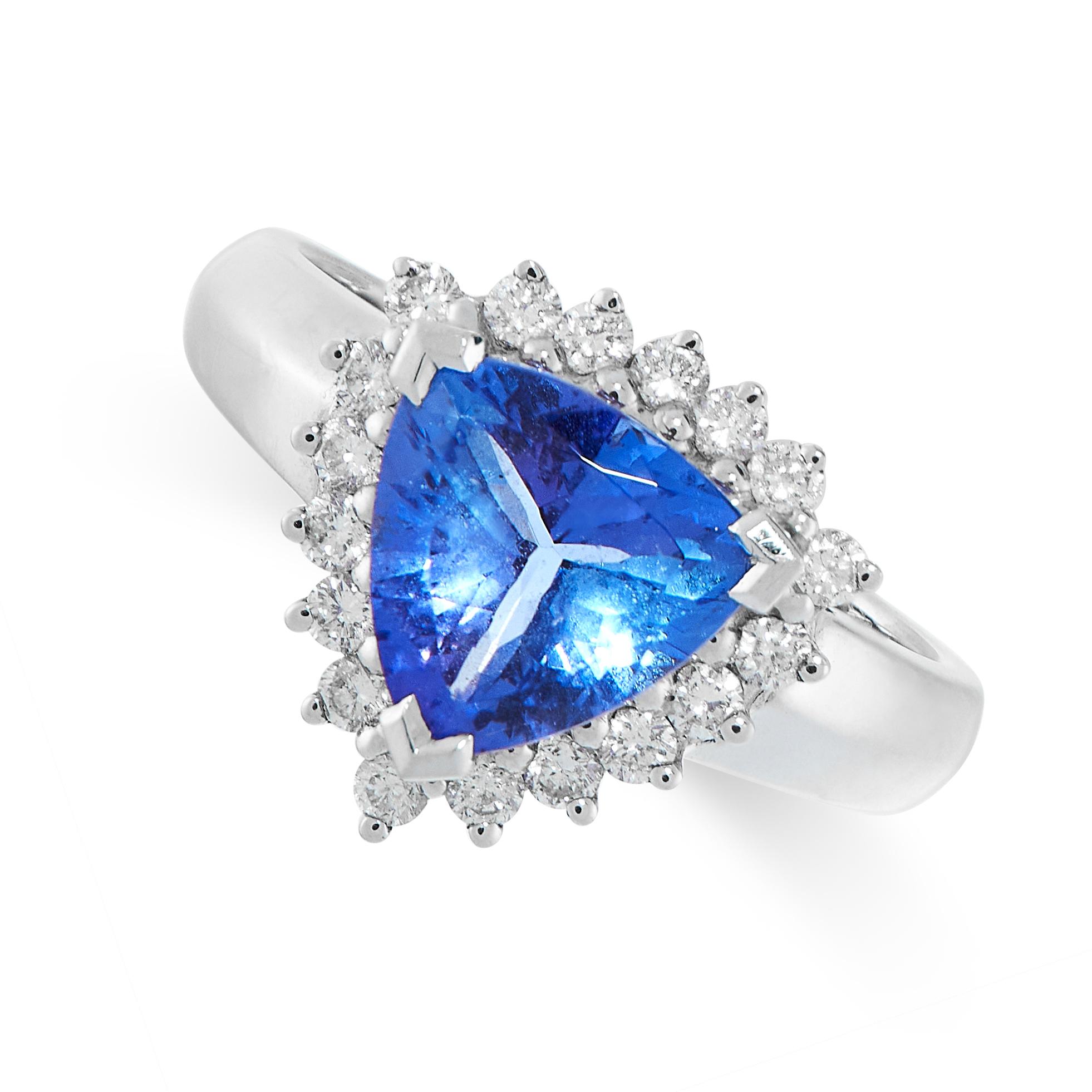 TANZANITE AND DIAMOND RING comprising of a trillion cut tanzanite of 1.92 carats in a border of