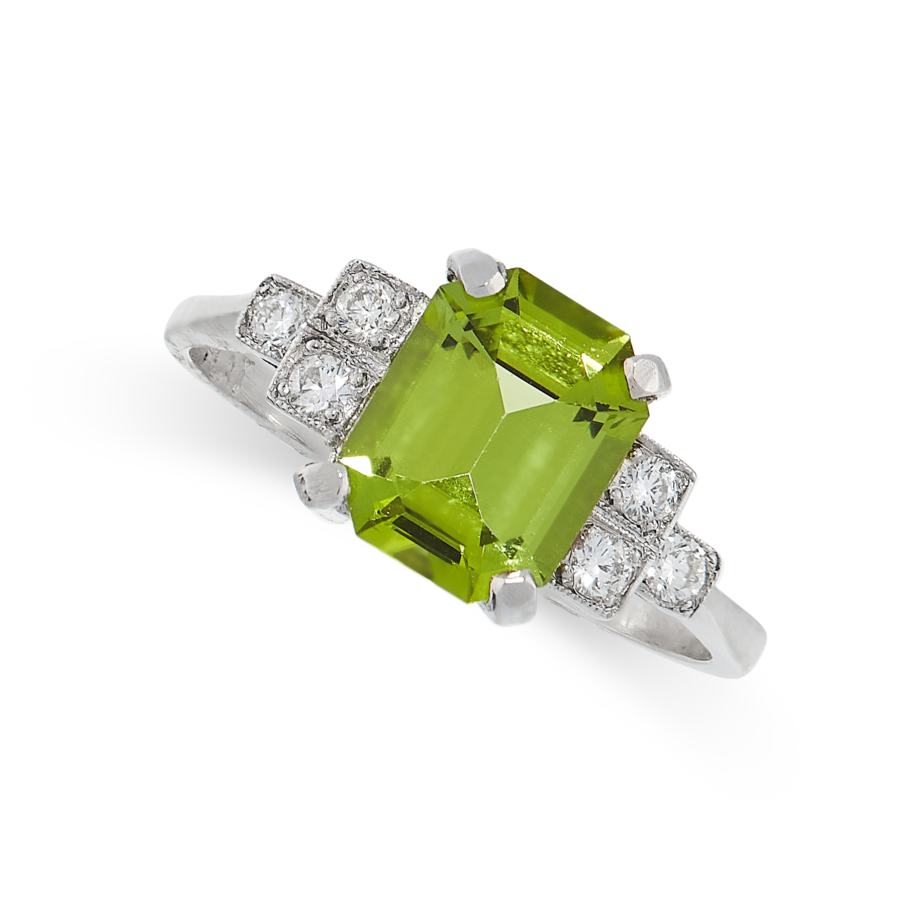PERIDOT AND DIAMOND RING in platinum set with an emerald cut peridot, accented by trios of round cut