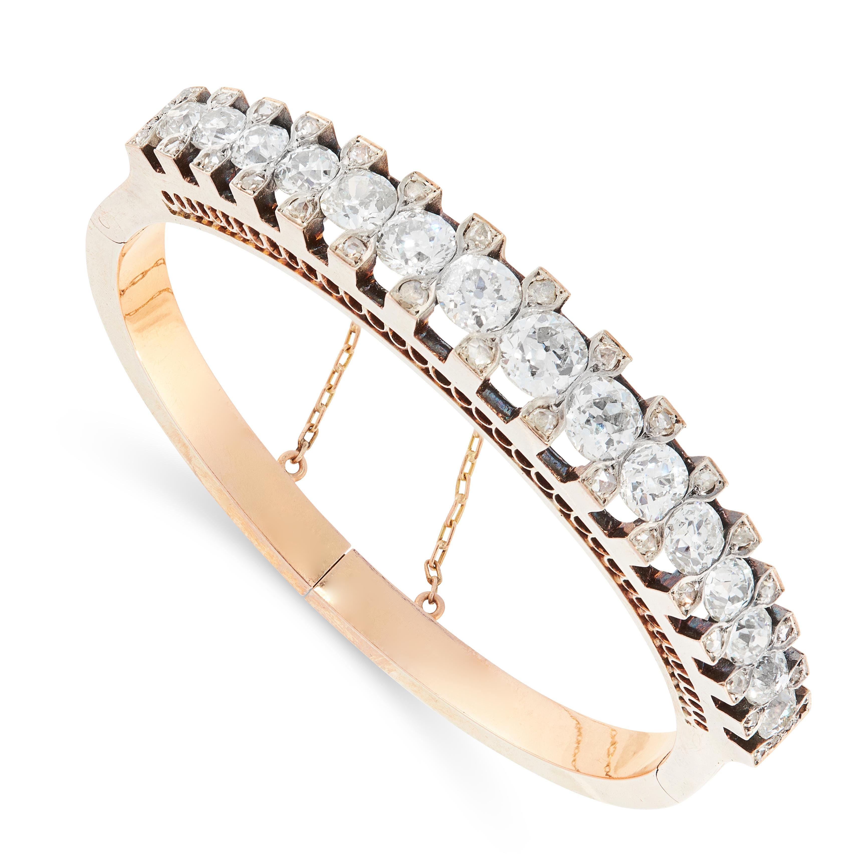 ANTIQUE DIAMOND BANGLE, 19TH CENTURY in 18ct yellow gold, comprising a single row of graduated old