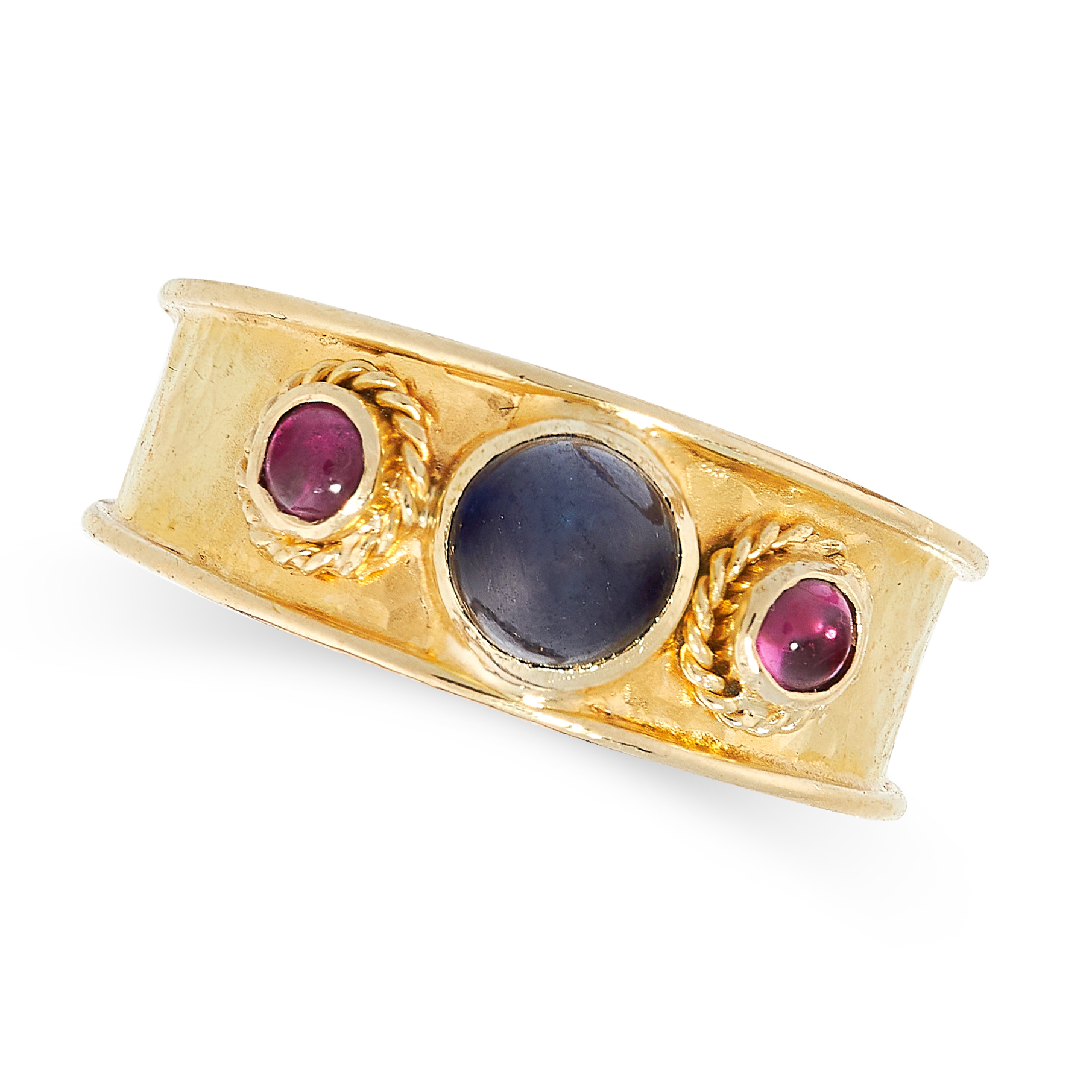 SAPPHIRE AND RUBY RING in 18ct yellow gold, the hammered gold band is set with a cabochon sapphire