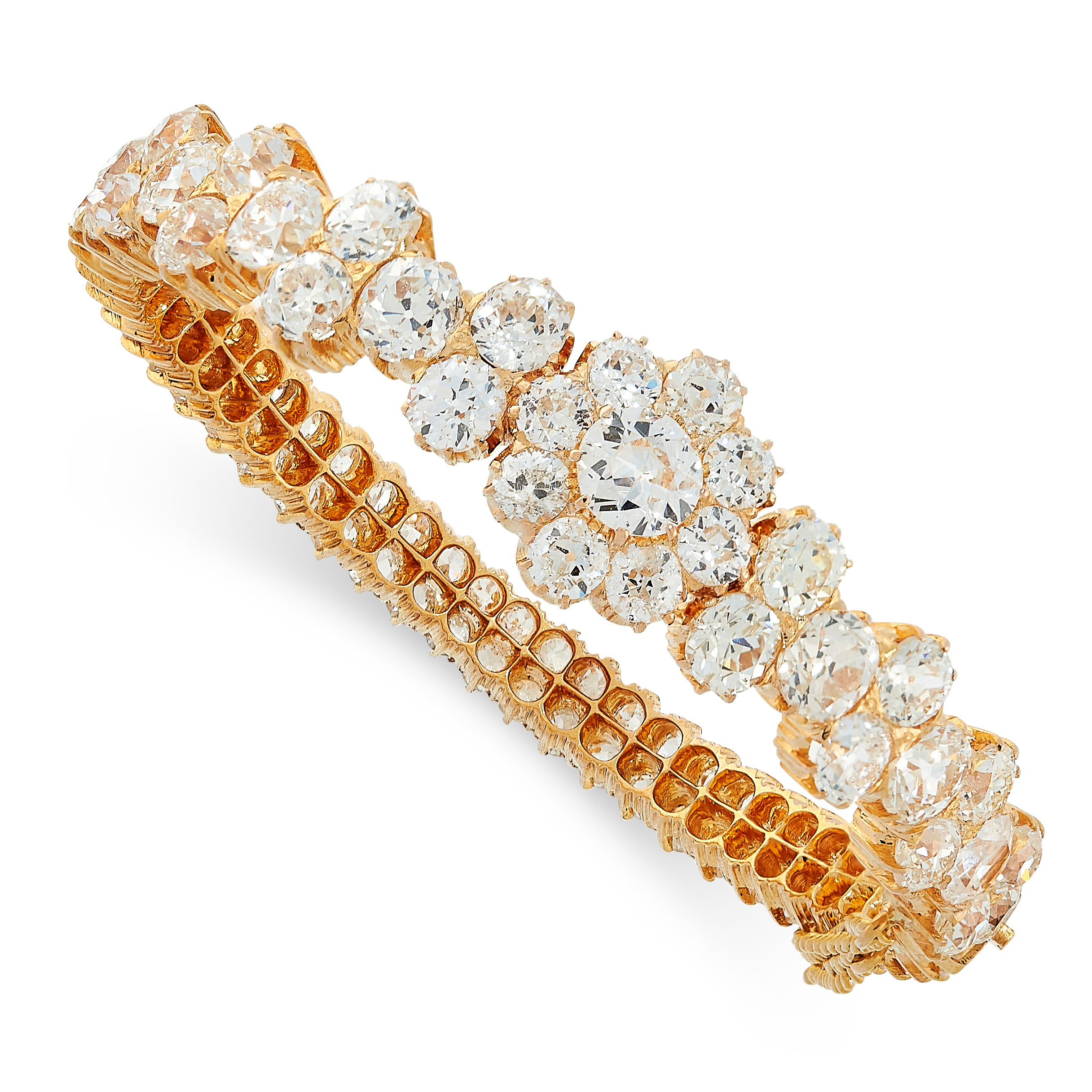 FINE DIAMOND BANGLE in yellow gold, set all around with clusters and rows of old cut diamonds, the