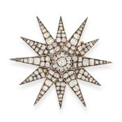 ANTIQUE DIAMOND STAR BROOCH / PENDANT, 19TH CENTURY in yellow gold and silver, designed as a star