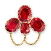 ANTIQUE PASTE BROOCH, 19TH CENTURY set with three graduated oval cut reddish pink paste gemstones,