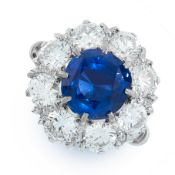 A CEYLON NO HEAT SAPPHIRE AND DIAMOND RING in 18ct white gold, set with a cushion cut blue
