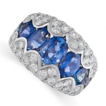 A SAPPHIRE AND DIAMOND RING in 18ct white gold, set with a row of graduated oval cut sapphires,