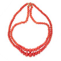 A CORAL BEAD NECKLACE in 18ct yellow gold, comprising two rows of graduated polished coral beads