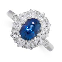 A SAPPHIRE AND DIAMOND CLUSTER RING in platinum, set with a cushion cut blue sapphire of 1.50