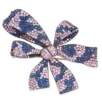 A PINK AND BLUE SAPPHIRE BROOCH in 18ct yellow gold and silver, designed as a ribbon tied in a
