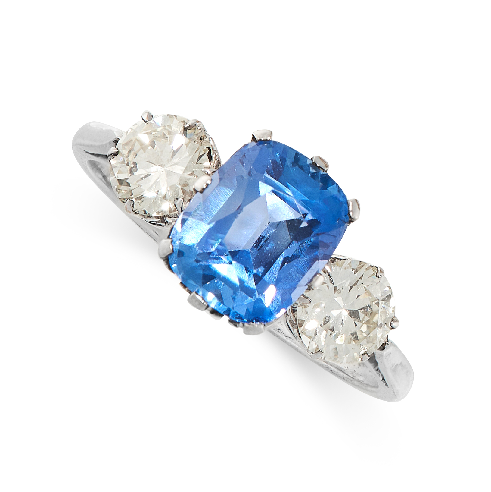 AN UNHEATED SAPPHIRE AND DIAMOND THREE STONE RING set with a cushion cut blue sapphire of 2.43