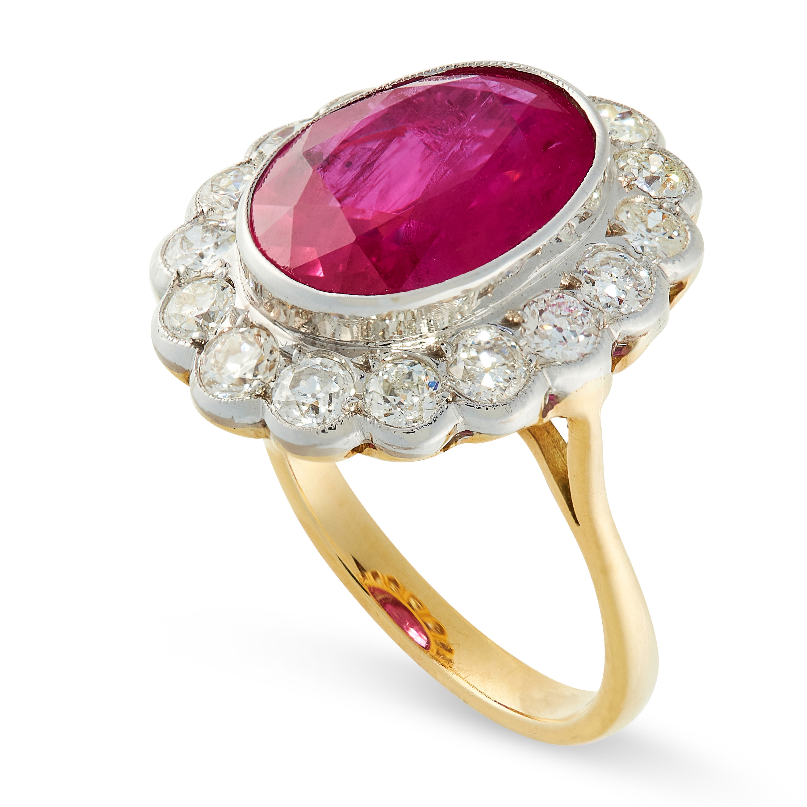 A RUBY AND DIAMOND RING in 18ct yellow gold, set with an oval cut ruby of 6.02 carats, within a - Image 2 of 2