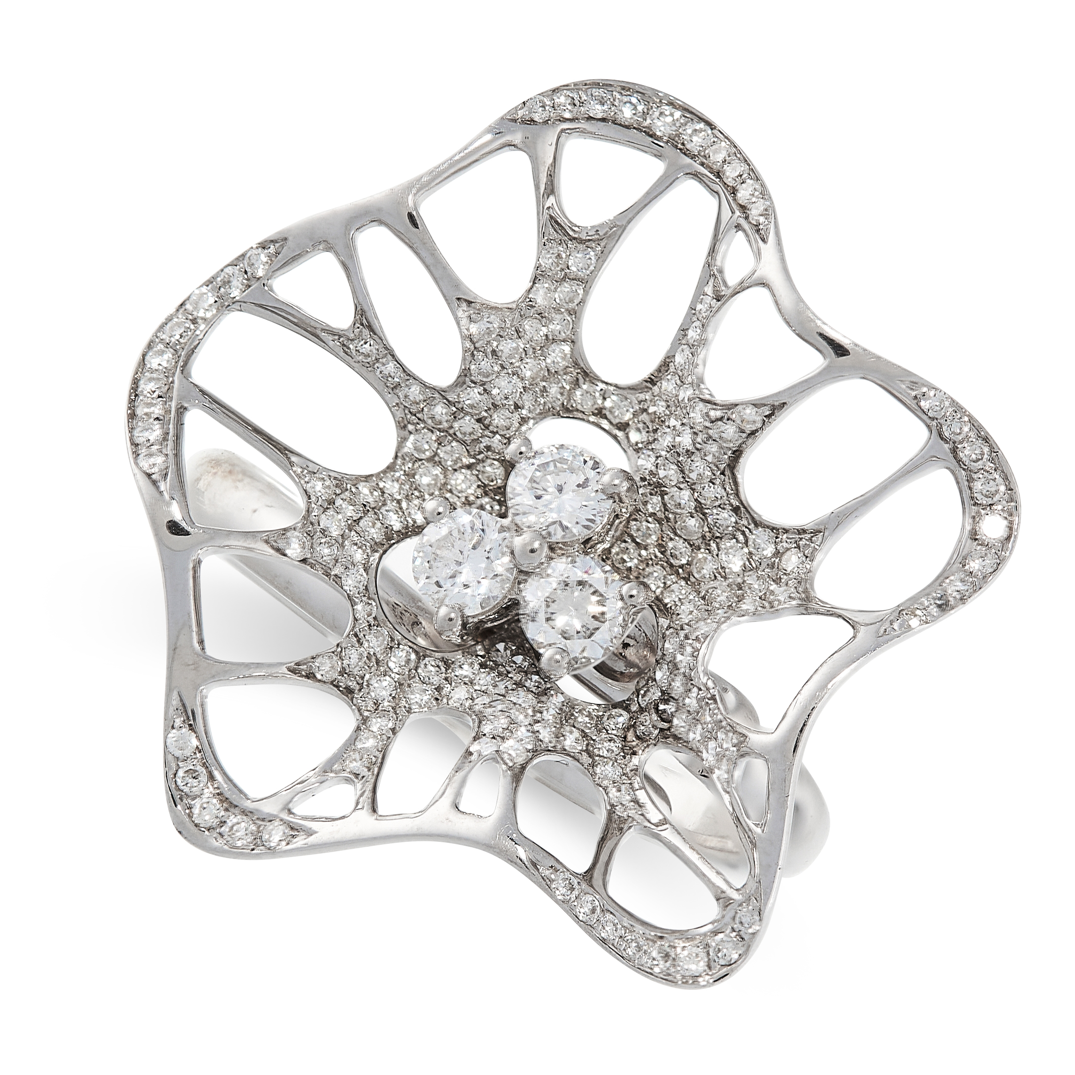 A DIAMOND RING in 18ct white gold, designed as an abstract flower, set with a central trio of