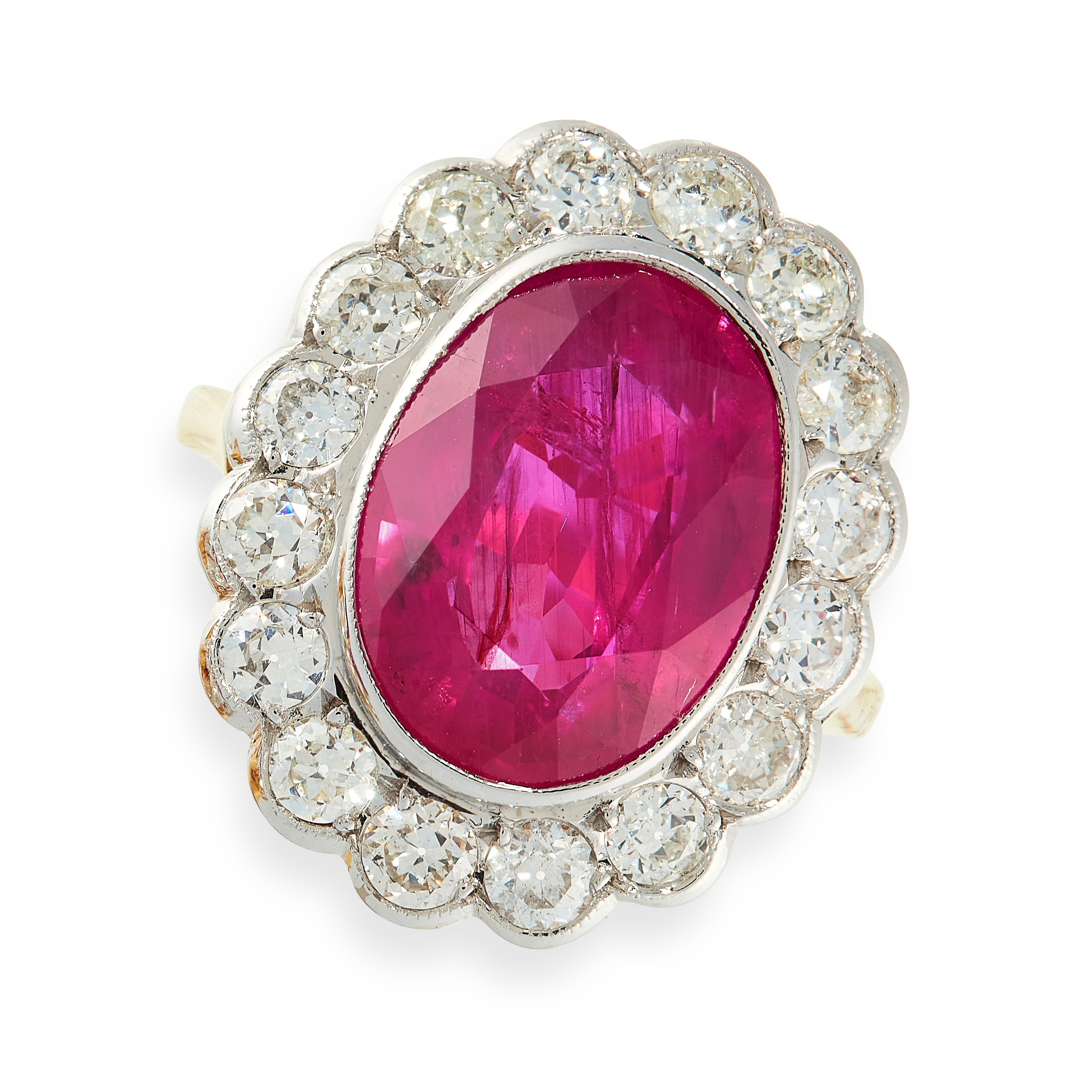 A RUBY AND DIAMOND RING in 18ct yellow gold, set with an oval cut ruby of 6.02 carats, within a