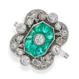 AN EMERALD AND DIAMOND RING in platinum, set with an old cut diamond within an octagonal border of