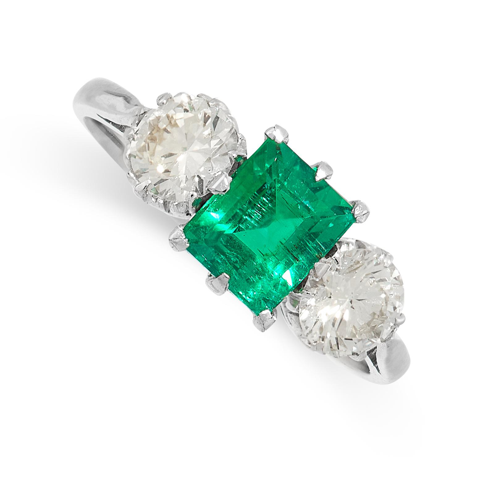AN EMERALD AND DIAMOND DRESS RING set with a rectangular step cut emerald of 1.19 carats, between