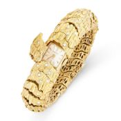A VINTAGE DIAMOND COCKTAIL WATCH, TIFFANY & CO in 18ct yellow gold, the articulated bracelet