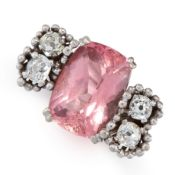 A VINTAGE PINK TOURMALINE AND DIAMOND RING, ANDREW GRIMA 1974 in 18ct white gold, set with a cushion
