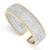 A DIAMOND CUFF BANGLE, BUCCELLATI in 18ct yellow gold and white gold, the open body of hinged