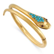 AN ANTIQUE TURQUOISE AND GARNET SNAKE BANGLE, 19TH CENTURY in yellow gold, the hinged body in the