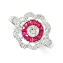 A RUBY AND DIAMOND RING in target design, the scalloped face set with an old cut diamond within a