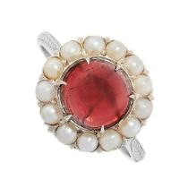 A GARNET AND PEARL RING in cluster design, set with a cabochon garnet of 2.98 carats in a border