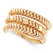 A SPIGA WRAP BRACELET / BANGLE, BULGARI in 18ct yellow gold, the coiled snake-like body formed of
