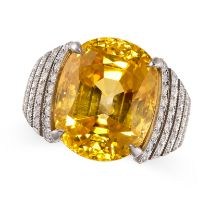 A MAGNIFICENT CEYLON NO HEAT YELLOW SAPPHIRE AND DIAMOND RING in platinum, set with a cushion cut