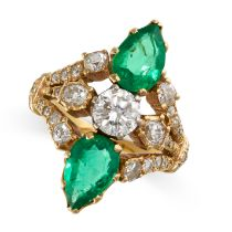 A COLOMBIAN EMERALD AND DIAMOND RING in 18ct yellow gold, set with two pear cut emeralds, both