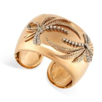 A VINTAGE DIAMOND CUFF BANGLE in 18ct yellow gold, the hinged body applied to the front with sprays