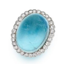AN AQUAMARINE AND DIAMOND RING in 18ct white gold and platinum, set with an oval cabochon aquamarine