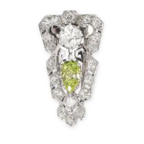 A FINE FANCY GREENISH YELLOW DIAMOND AND WHITE DIAMOND CLIP BROOCH of shield shaped design, set with