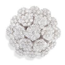 A DIAMOND COCKTAIL RING in 18ct white gold, the hexagonal face designed as a flower, formed of a
