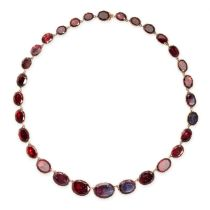 AN ANTIQUE GARNET RIVIERE NECKLACE, 19TH CENTURY in yellow gold, comprising a single row of thirty