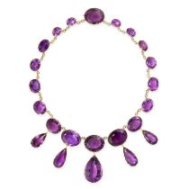 A SENSATIONAL ANTIQUE AMETHYST RIVIERE NECKLACE, CIRCA 1875 in yellow gold, comprising a row of