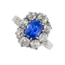 A KASHMIR SAPPHIRE AND DIAMOND RING in 18ct gold, set with a cushion cut blue sapphire of 1.76