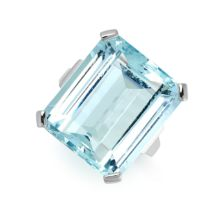 AN AQUAMARINE RING set with an emerald cut aquamarine weighing 19.57 carats, stamped 750, size L /