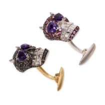 A PAIR OF AMETHYST AND SAPPHIRE SKULL CUFFLINKS in 18ct white and yellow gold, each designed as a
