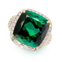 A GREEN TOURMALINE AND DIAMOND RING in yellow gold, set with a cushion shaped green tourmaline