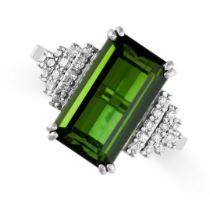 A GREEN TOURMALINE AND DIAMOND RING set with a step cut green tourmaline weighing 4.66 carats,