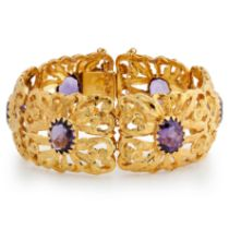 AN AMETHYST BRACELET composed of open work panels of floral design with engraved details, each