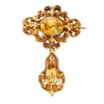 AN ANTIQUE CITRINE BROOCH, MID 19TH CENTURY set with an oval citrine, within a stamped foliate