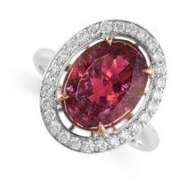 A PINK TOURMALINE AND DIAMOND RING set with an oval cut pink tourmaline weighing 3.93 carats