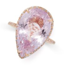 A KUNZITE AND DIAMOND RING set with a pear shaped kunzite weighing 12.92 carats in a border of round
