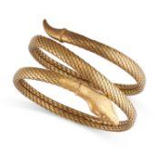 A SNAKE BANGLE / BRACELET the body designed as a snake coiled around on itself, no assay marks,