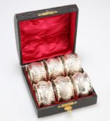 A SET OF SIX LATE VICTORIAN SILVER NAPKIN RINGS