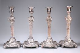A SET OF FOUR OLD SHEFFIELD PLATE CANDLESTICKS
